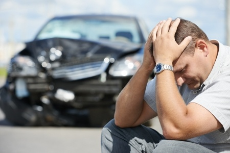 A depressed man in front of a car crash, Overcorrecting