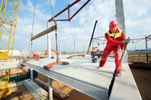 builder worker installing concrete slab