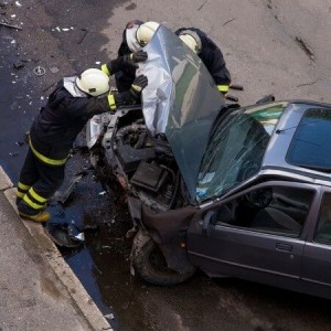Fireman at a car crash, automotive technology